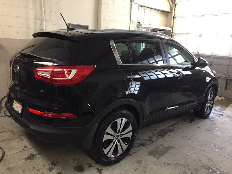 2011 Kia after collision repair back view