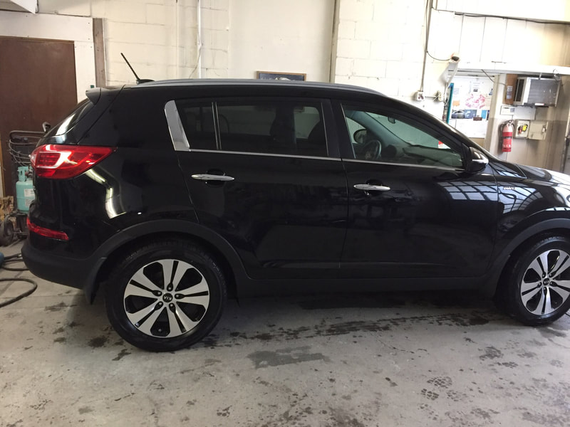 2011 Kia after repair, side view
